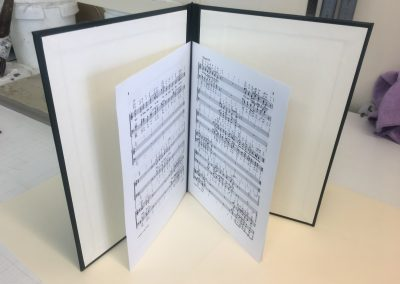A case made for a customer to keep their music scores protected. (Inside)