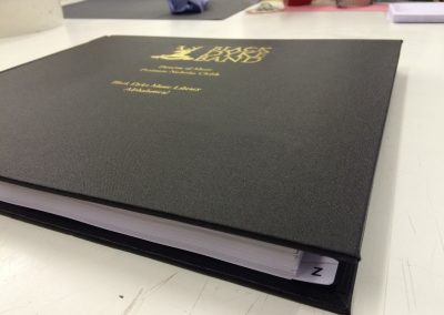 Large bound book of music scores with personal logo blocked in gold
