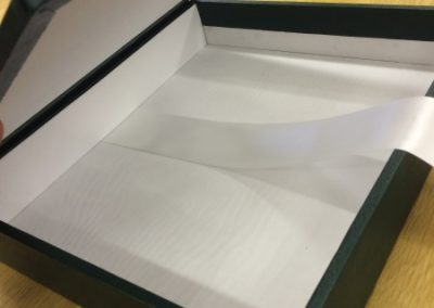 Inside of the hand made box, lined with special white siltex, accompanied with a white opening ribbon